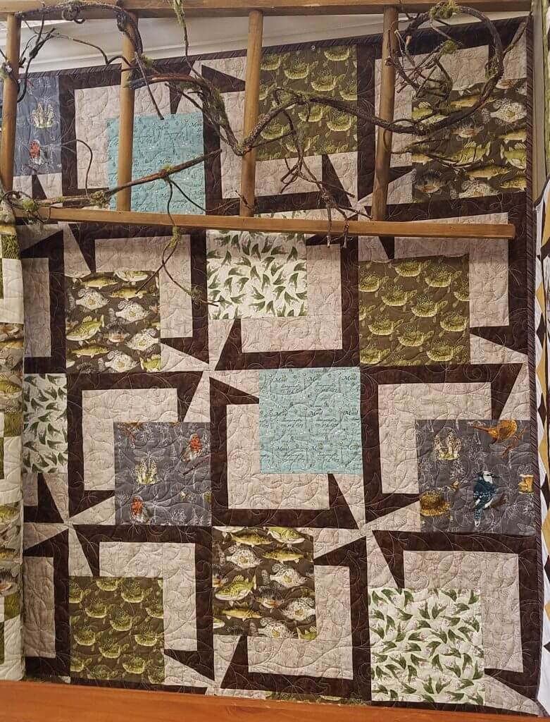 "Quilt Haven on Main used BQ5 for the Minnesota Shop Hop fabric line. A wonderful way to feature a collection. 20 – 13 ½"" blocks 54"" x 67.5"". www.quilthavenonmain.com"